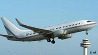 A Boeing 737 with registration number N313P is seen taking off from Spain's San Joan Palma de Mallorca airport March 12, 2004. This airplane is mentioned, with registration number N313P, in a report by police investigating the case, for allegedly being used by the CIA to transport Islamic terror suspects.