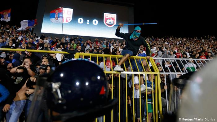 Serbian fans clash with riot police at last year's match