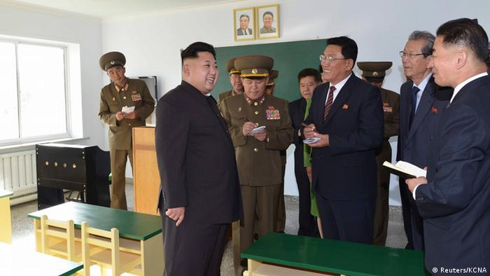North Korean leader Kim Jong Un gives field guidance at the newly built Wisong Scientists Residential District in this undated photo released by North Korea's Korean Central News Agency (KCNA) in Pyongyang October 14, 2014 REUTERS/KCNA (NORTH KOREA - Tags: POLITICS) ATTENTION EDITORS - THIS PICTURE WAS PROVIDED BY A THIRD PARTY. REUTERS IS UNABLE TO INDEPENDENTLY VERIFY THE AUTHENTICITY, CONTENT, LOCATION OR DATE OF THIS IMAGE. FOR EDITORIAL USE ONLY. NOT FOR SALE FOR MARKETING OR ADVERTISING CAMPAIGNS. THIS PICTURE IS DISTRIBUTED EXACTLY AS RECEIVED BY REUTERS, AS A SERVICE TO CLIENTS. NO THIRD PARTY SALES. NOT FOR USE BY REUTERS THIRD PARTY DISTRIBUTORS. SOUTH KOREA OUT. NO COMMERCIAL OR EDITORIAL SALES IN SOUTH KOREA