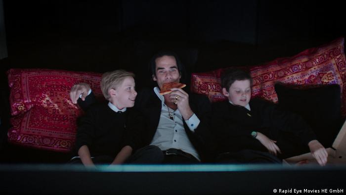 "Cave sits on a sofa with his two kids in a still from the film ""20,000 Days on Earth"" (Rapid Eye Movies HE GmbH)"