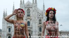 Bildunterschrift:Inna Shevchenko (L), leader of the women's rights organization Femen, along with another activist, protest against Russia's President Vladimir Putin on the first day of the 10th Asia-Europe Meeting (ASEM) on October 16, 2014 at the Piazza del Duomo in Milan. Vladimir Putin will take centre stage at an Asia-Europe (ASEM) summit that opens today in Milan, where the Russian leader due to hold face-to-face talks with Ukraine counterpart Petro Poroshenko. AFP PHOTO / MARCO BERTORELLO (Photo credit should read MARCO BERTORELLO/AFP/Getty Images)