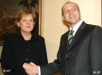 Angela Merkel with Polish Prime Minister Kazimierz Marcinkiewicz