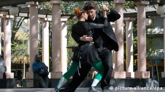 A man and a woman dancing a Tango on a street in Montevideo