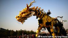 A mechanical installation named Long Ma makes it way during the Long Ma performance in front of the National Stadium, also known as the Bird's Nest, in Beijing October 17, 2014. Long Ma, a 17-meter (56-ft) long and 15-meter (49-ft) tall mechanized dragon sculpture, and The Spider, a 5.7-meter (19-ft) tall and 6-meter (20-ft) wide machine, are operated by French performance art company La Machine. The structures are operated by an automatic control system and electronic equipment. The performance, which combines Chinese culture and French art, was held in Beijing in honour of the 50th anniversary of the establishment of diplomatic relations between the two countries, an organiser of the event said. REUTERS/Kim Kyung-Hoon (CHINA - Tags: POLITICS SOCIETY)