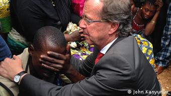 Martin Kobler comforts a small boy