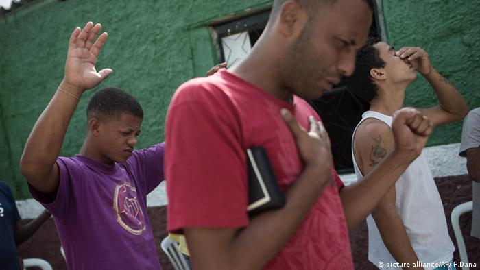 Former drug users during a morning prayer at the God's Love rehabilitation center in Rio de Janeiro, Brazil (Photo: AP Photo/Felipe Dana)