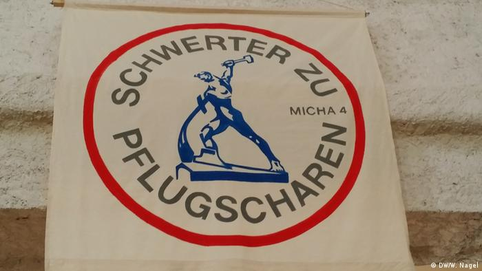 A sign for the swords to plowshares campaing