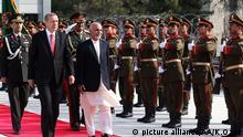 KABUL, AFGHANISTAN - OCTOBER 18 : Turkish President Recep Tayyip Erdogan (L) walks next to Afghan President Ashraf Ghani Ahmadzai (R) during an official visit in Kabul, Afghanistan October 18, 2014. Kayhan Ozer / Anadolu Agency