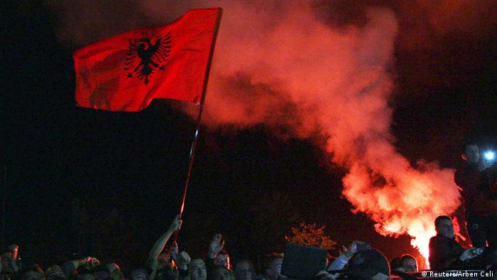 Albanian fans wait for Albania's national soccer players to arrive