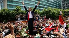 Indonesian President Joko Widodo gestures to the crowd during a street parade following his inauguration in Jakarta, Indonesia, Monday, Oct. 20, 2014. (AP Photo/Achmad Ibraham)