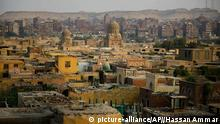This Oct. 10, 2014, photo shows a general view of cemeteries located in the City of the Dead, a slum where half a million people live among tombs, in Cairo. The reality of relying on finite land resources to cope with the endless stream of the dying has brought about creative solutions. (AP Photo/Hassan Ammar)
