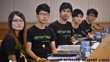 Leaders of the Hong Kong Federation of Students (L-R) Yvonne Leung, Eason Chung, Nathan Law, Alex Chow, Lester Shum and Nathan Law look on before long-awaited talks between the student leaders and senior government officials in Hong Kong on October 21, 2014. Hong Kong's leader Leung Chun-ying has said open elections would result in the city's many poor dominating politics, as he ruled out democratic reforms before crucial talks aimed at ending three weeks of protest rallies. AFP PHOTO / Philippe Lopez (Photo credit should read PHILIPPE LOPEZ/AFP/Getty Images)