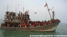 Suspected human trafficking victims are crammed on a Thai trawler, which was rescued by the Bangladesh Coast Guard, in southern Bangladesh on June 11, 2014, in this handout picture provided by the Bangladesh Coast Guard. More than 300 suspected human trafficking victims were rescued by the Bangladesh Coast Guard following a deadly shooting incident. To match Special Report THAILAND-TRAFFICKING/ REUTERS/Bangladesh Coast Guard/Handout via Reuters (BANGLADESH - Tags: CIVIL UNREST CRIME LAW MARITIME TPX IMAGES OF THE DAY) ATTENTION EDITORS - THIS PICTURE WAS PROVIDED BY A THIRD PARTY. REUTERS IS UNABLE TO INDEPENDENTLY VERIFY THE AUTHENTICITY, CONTENT, LOCATION OR DATE OF THIS IMAGE. FOR EDITORIAL USE ONLY. NOT FOR SALE FOR MARKETING OR ADVERTISING CAMPAIGNS. NO SALES. NO ARCHIVES