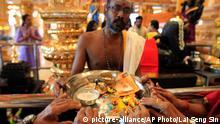 Hindu devotees offer prayers during Diwali, or the Hindu festival of lights, at Sri Mahamariamman Temple in Klang, outside Kuala Lumpur, Malaysia, Wednesday, Oct. 22, 2014. (AP Photo/Lai Seng Sin)