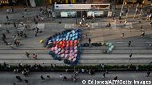 A general view shows an art installation featuring a giant umbrella made up of umbrellas, on a road occupied by pro-democracy protesters in the Causeway Bay district of Hong Kong on October 11, 2014. A Hong Kong pro-government group said Saturday demonstrators occupying main roads to protest for full democracy would find themselves surrounded if the city's administration failed to clear the barricades. AFP PHOTO / Ed Jones (Photo credit should read ED JONES/AFP/Getty Images)
