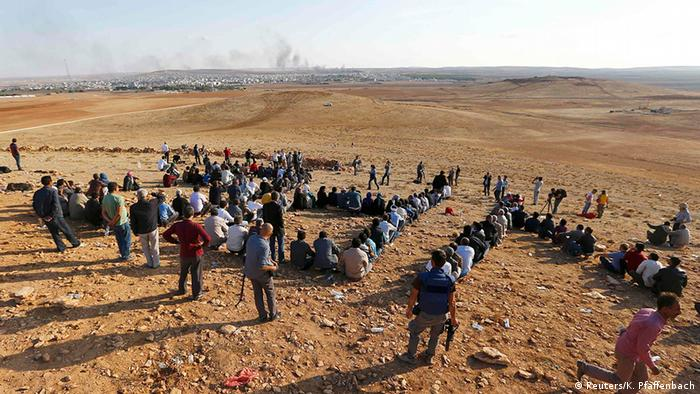 Turkish Kurds gather on the hill near the Mursitpinar border crossing on the Turkish-Syrian border near the southeastern town of Suruc in Sanliurfa province to support Kurdish fighters in Koban October 15, 2014