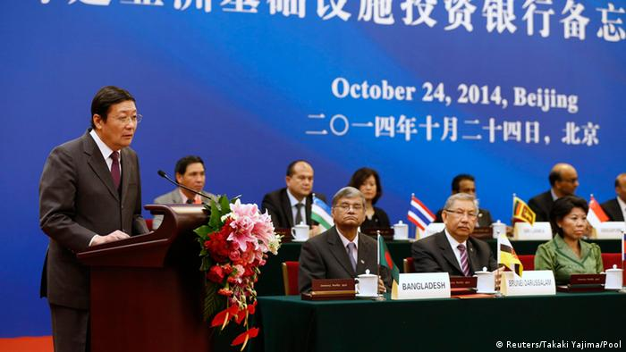 China's Finance Minister Lou Jiwei (L) gives a speech, with the guests of the signing ceremony of the Asian Infrastructure Investment Bank at the Great Hall of the People in Beijing October 24, 2014 (Photo: REUTERS/Takaki Yajima/Pool)