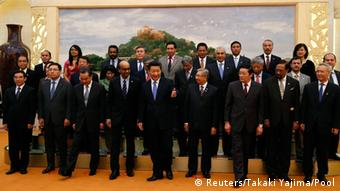 China's President Xi Jinping (front C) guides guests at the Asian Infrastructure Investment Bank launch ceremony at the Great Hall of the People in Beijing October 24, 2014 (Photo: REUTERS/Takaki Yajima/Pool)