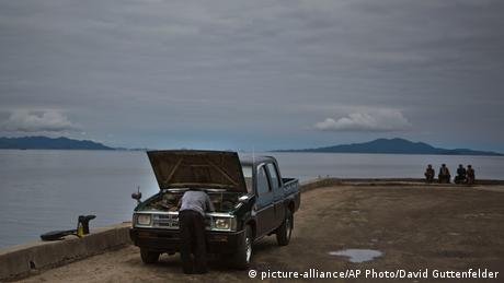 A car breaks down along the Wonsan Sea in North Korea