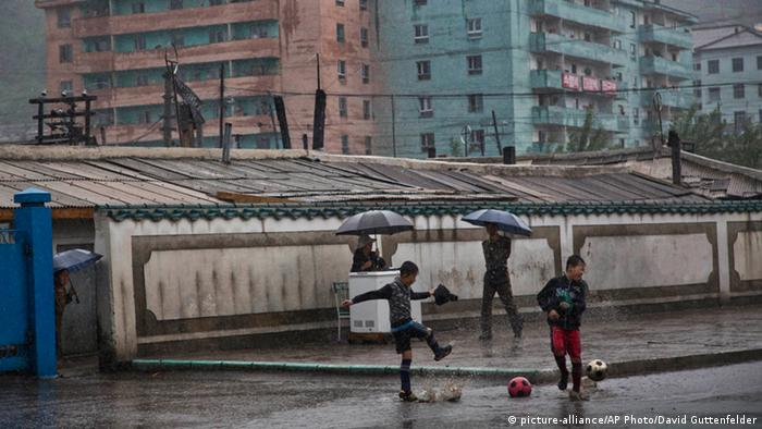 Boys playing soccer in North Korea