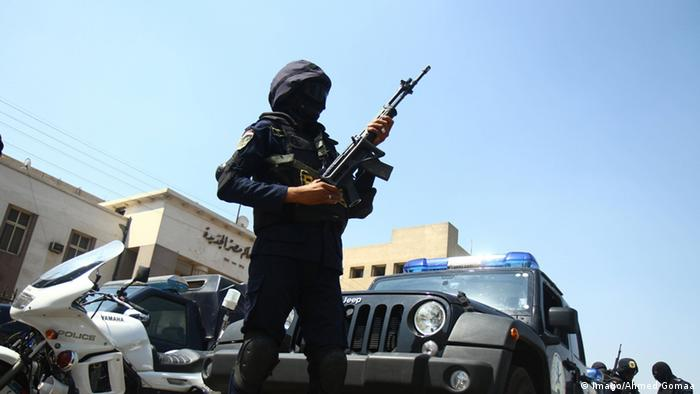 A June 25, 2014 file photo, showing an Egyptian policeman standing guard at the site of a bomb blast.