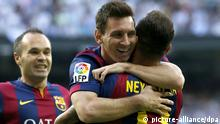 FC Barcelona's Brazilian striker Neymar jr (L) jubilates with his team mate, Argentinian striker Lionel Messi (C) and midfielder Andres Iniesta (L) his goal against Real Madrid during their Primera Division soccer match played at Santiago Bernabeu stadium in Madrid, Spain on 25 October 2014. EFE/Chema Moya