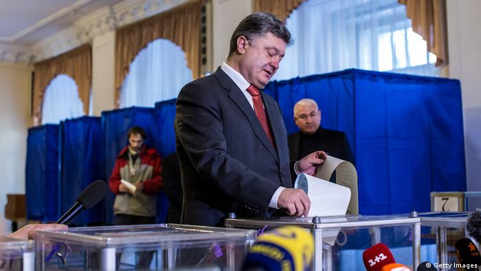 Ukraine President Petro Poroschenko casts his vote on Sunday October 26