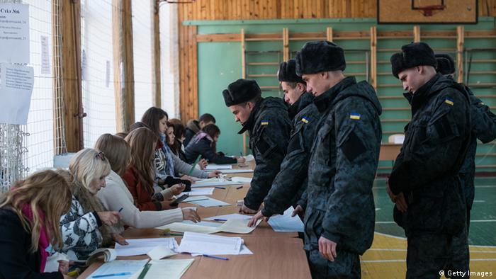 Ukrainian soldiers pictured in a polling station