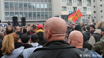 Two men with shaved heads are pictured at the rally in Cologne