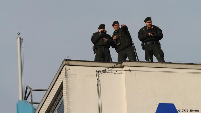 Members of German intelligence look on from above the rally