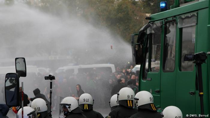 Water cannons are fired after protests escalated in Cologne