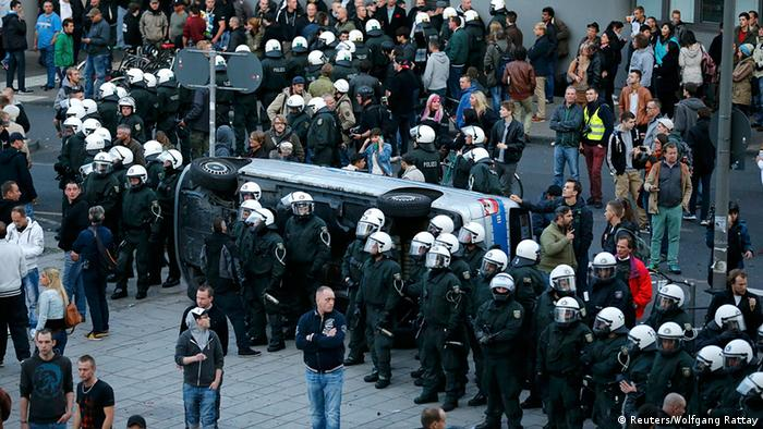 Police, hooligans in Cologne. Photo: REUTERS/Wolfgang Rattay