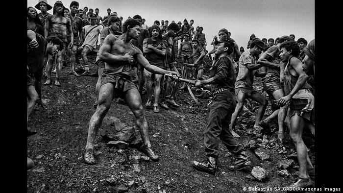 conflict between mine workers and Brazlian military police during the gold rush in Serra Pelada (Sebastião SALGADO/Amazonas images)