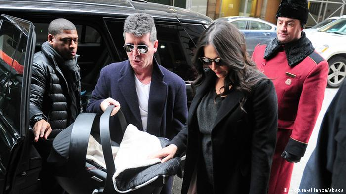 Simon Cowell and girlfried Lauren with baby Eric