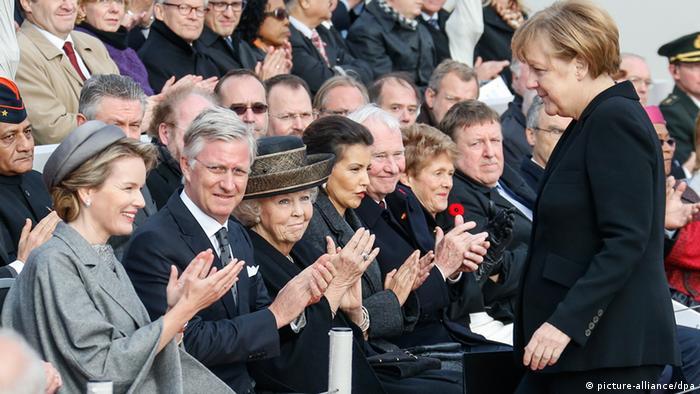 Angela Merkel stands before a crowd in Belgium