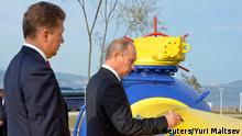 Russia's Prime Minister Vladimir Putin (R) and Gazprom CEO Alexei Miller attend a gas pipeline opening ceremony in Russia's far eastern city of Vladivostok, in this September 8, 2011 file photo. An offer by Gazprom to help rival Rosneft salvage an Arctic oil project shows how tightly sanctions have bound Russia's political and business elite together in the Ukraine crisis - an unintended consequence of the West's punitive measures. Picture taken September 8, 2011. To match Insight UKRAINE-CRISIS/ENERGY-RUSSIA REUTERS/Yuri Maltsev/Files (RUSSIA - Tags: POLITICS ENERGY BUSINESS)