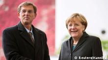 German Chancellor Angela Merkel (R) welcomes Slovenia's Prime Minister Miro Cerar to review the honour guard before talks at the Chancellery in Berlin October 30, 2014. REUTERS/Hannibal (GERMANY - Tags: POLITICS)