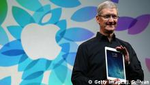 SAN FRANCISCO, CA - OCTOBER 22: Apple CEO Tim Cook holds the new iPad Air during an Apple announcement at the Yerba Buena Center for the Arts on October 22, 2013 in San Francisco, California. The tech giant announced its new iPad Air, a new iPad mini with Retina display, OS X Mavericks and highlighted its Mac Pro. (Photo by Justin Sullivan/Getty Images)