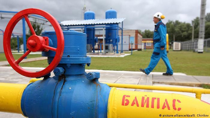 Ukrainian worker passes gas pipes at a new East Poltavske booster compressor station, in a village of Petrivka, outside Poltava, Ukraine, 27 June 2014. (Photo: EPA/SERGEI CHIRIKOV)