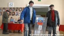 epa04470349 Local elections committee members carry a ballot box at a polling station in Luhansk, Ukraine, 30 October 2014. Pro-Russian separatists prepare to hold elections of their leaders and parliaments in both the self-proclaimed Donetsk and Luhansk 'people's republics' on 02 November 2014. Ukraine and western governments have denounced the elections as illegal and as a threat to last month's ceasefire accord. EPA/YURIY STRELTSOV