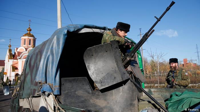 Pro-Russian separatists guard their positions on a street in Makiivka, outside Donetsk