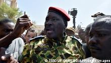 Lieutenant-Colonel Yacouba Issaac Zida (C) arrives at the Place de la Nation square on October 31, 2014 in Ouagadougou after the resignation of Burkina Faso's President Blaise Compaore. The deposed president of Burkina Faso, Blaise Compaore, is 'in a safe place' and his 'safety and well-being are assured', Colonel Isaac Zida, second in command of the presidential guard, said on November 1st. Zida, who had just declared himself head of state, told journalists that Compaore, who resigned on October 31, and his chief of staff 'are in a safe place and their safety and well-being are assured.' AFP PHOTO / ISSOUF SANOGO (Photo credit should read ISSOUF SANOGO/AFP/Getty Images)