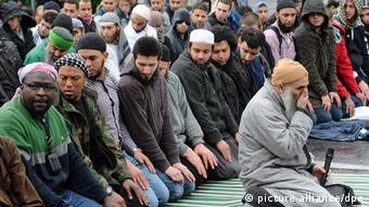 A group of Salafists sit at a gathering in Bonn in 2012