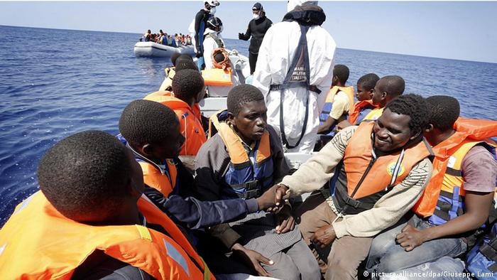 African refugees on a boat in the Mediterranean