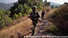 In this Monday, Dec. 23, 2013 photo, Indian army soldiers patrol near one of their forward post at the Line of Control (LOC), that divides Kashmir between India and Pakistan, at Krishna Ghati (KG Sector) in Poonch, 290 kilometers (180 miles) from Jammu, India. The military commanders of India and Pakistan met on Tuesday in a bid to stop frequent cross-border attacks in disputed Kashmir which escalated tensions in the region in recent months. The commanders reiterated the resolve and commitment of both sides to continue efforts of ensuring ceasefire, peace and tranquility on the ceasefire line. (AP Photo/Channi Anand) pixel