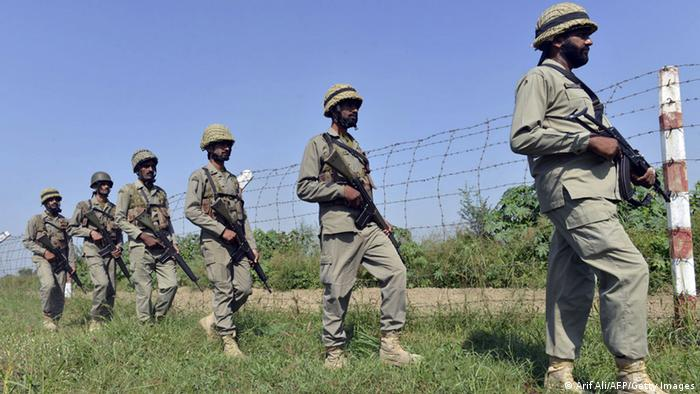 Pakistani Rangers patrol along the Pakistan-India border area of Wagah on October 16, 2014.