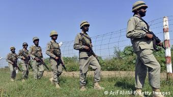 Pakistani soldiers patrol the border with the Indian-controlled part of Kashmir