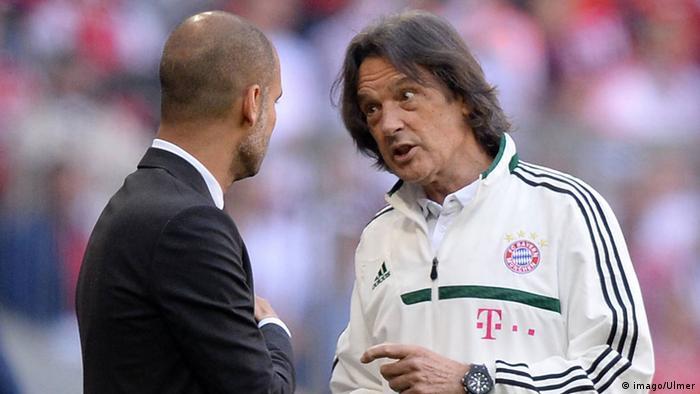 Bayern Munich coach Pep Guardiola speaks with Hans-Wilhelm Müller-Wohlfahrt