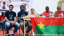 Burkina Faso's rap artist Smockey (L) and reggae artist Sams K Le Jah give a press conference in Ouagadougou on August 25, 2013 after the launch of their new movement named Le Balai citoyen. AFP PHOTO / AHMED OUOBA (Photo credit should read AHMED OUOBA/AFP/Getty Images)