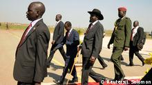 South Sudanese President Salva Kiir (C) is escorted by senior government officials on his arrival at the airport in Juba, November 5, 2014. President Kiir is well despite slipping when he boarded a plane in Khartoum that had been due to fly him home on Tuesday, the presidential spokesman said. A technical fault with the aircraft delayed his departure, however. Kiir, who has led South Sudan since it seceded from Sudan in 2011, had been in Khartoum for talks with Sudanese President Omar Hassan al-Bashir on security and other issues. REUTERS/Jok Solomon (SOUTH SUDAN - Tags: SOCIETY POLITICS)